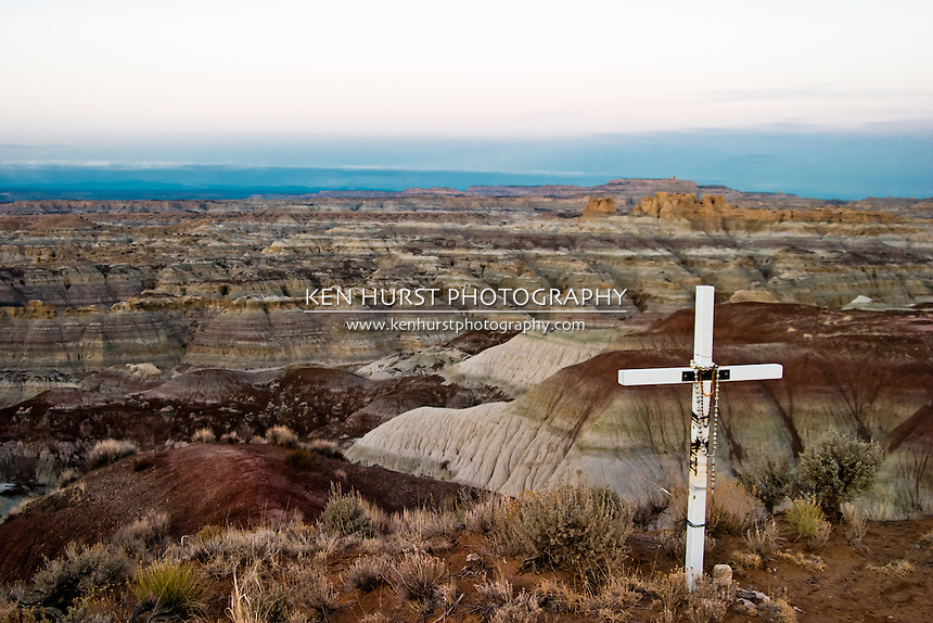 Cross memorial with view of Castle Rock formation in the background at the Angel Peak National Recreation Area near Farmington, New Mexico.