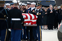 Former President George W. Bush, Laura Bush and other family members watch as the flag-draped casket of former President George H.W. Bush is carried by a joint services military honor guard to Special Air Mission 41, Wednesday, Dec. 5, 2018, at Andrews Air Force Base, Md.<br /> CAP/MPI/RS<br /> &copy;RS/MPI/Capital Pictures