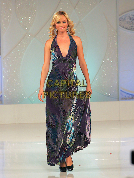 AMBER VALLETTA.attends Runway for Life, Benefiting St. Jude Children's Research Hospital held at The Beverly Hilton Hotel in Beverly Hills, California, USA, September 15th 2006..full length fashion modelling catwalk show grey silver blue patterned print dress holding skirt valetta valleta.Ref: DVS.www.capitalpictures.com.sales@capitalpictures.com.©Debbie VanStory/Capital Pictures