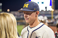 Michigan Wolverines first baseman Jimmy Kerr (15) is interviewed after beating the Vanderbilt Commodores in Game 1 of the NCAA College World Series Finals on June 24, 2019 at TD Ameritrade Park in Omaha, Nebraska. Michigan defeated Vanderbilt 7-4. (Andrew Woolley/Four Seam Images)