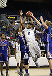 Bishop Gorman's Jamal Bey shoots past Reno defenders Michael Heydon, center, and David Kyle, right, during the NIAA Division I state basketball tournament in Reno, Nev. on Thursday, Feb. 25, 2016. Gorman won 70-39. Cathleen Allison/Las Vegas Review-Journal