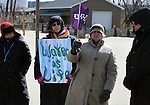 Detail photo as, Stacy Lipari, of Rosendale's, Creative Coop, is among the individual participants announce upcoming events in their communities, at the end of a Native American Water Blessing Ceremony held for the Hudson River, sponsored by the Association of Native American of the Hudson Valley, at Kingston Point Beach in Kingston, NY, on Saturday, March 4, 2017. Photo by Jim Peppler; Copyright Jim Peppler 2017