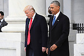 United States President Donald Trump and former US President Barack Obama walk out of the East front prior to Obama's departure from the 2017 Presidential Inauguration at the US Capitol in Washington, DC on January 20, 2017.<br /> Credit: Jack Gruber / Pool via CNP