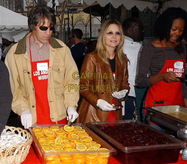 DAVID E. KELLEY & MICHELLE PFEIFFER.volunteer as The Los Angeles Mission Serve Up Holiday Cheer for the Homeless of Skid Row in Downtown Los Angeles, California on Christmas Eve .24 December 2003  .**UK Sales Only**   .food   .www.capitalpictures.com.sales@capitalpictures.com.©Capital Pictures.