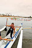 USA, California, San Diego, a women exits her boat after rowing around Vacation Isle, Mission Bay Park