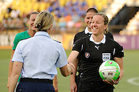 Referee Margaret Domka accepts the game ball from a member of the Coast Guard during the Women's Professional Soccer (WPS) All-Star Game at KSU Stadium in Kennesaw, GA, on June 30, 2010.