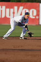 Burlington Bees Jake Yacinich (7) fields a ground ball during the Midwest League game against the Peoria Chiefs at Community Field on June 9, 2016 in Burlington, Iowa.  Peoria won 6-4.  (Dennis Hubbard/Four Seam Images)