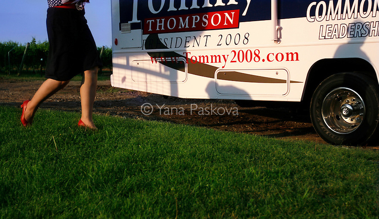 Republican Presidential hopeful Tommy Thompson (R-WI) planned to campaign in Ames, Iowa, on July 06, 2007, until a plane malfunction thwarted his plans.  One of his campaign volunteers walks by the grounds on which he was scheduled to speak.