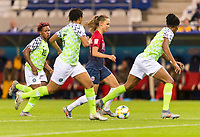 REIMS, FRANCE - JUNE 08: Caroline Graham Hansen #10 dribbles the ball between Nigerian defenders during a game between Norway and Nigeria at Stade Auguste-Delaune on June 8, 2019 in Reims, France.