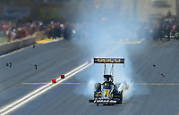 Jul, 22, 2012; Morrison, CO, USA: NHRA top fuel dragster driver Morgan Lucas races through a flock of birds at the finish line during the Mile High Nationals at Bandimere Speedway. Mandatory Credit: Mark J. Rebilas-