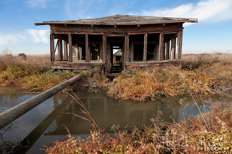 The abandoned shack that was once the Precita Gun Club slowly sinks into the marsh at the ghost town of Drawbridge in southern San Francisco Bay. Drawbridge was a hunting village started in the 1880's with the last resident leaving in the 1970's.