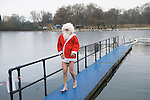 Father Christmas. Christmas Day Morning Swim. Serpentine Lido  Swimming Club London. Annual 100 metre Peter Pan Cup race cancelled due to ice. Uk.