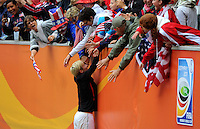 Megan Rapinoe of team USA celebrates with spectators during the FIFA Women's World Cup at the FIFA Stadium in Moenchengladbach, Germany on July 13th, 2011.