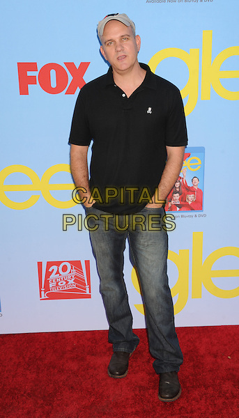 Mike O'Malley.The 'GLEE' Premiere Screening and Reception at Paramount Pictures Studios in Hollywood, California, USA..September 12, 2012.full length top hands in pockets jeans denim black baseball cap hat grey gray  .CAP/ROT/TM.©Tony Michaels/Roth Stock/Capital Pictures