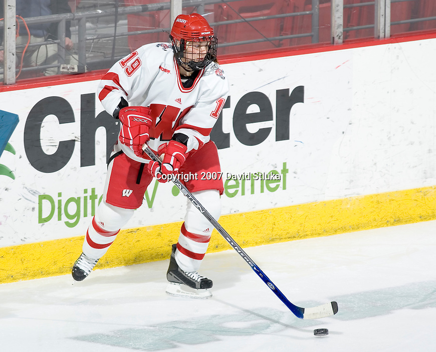 MADISON, WI - FEBRUARY 16: Alycia Matthews #19 of the Wisconsin Badgers women's hockey team handles the puck against the Bemidji State Beavers at the Kohl Center on February 16, 2007 in Madison, Wisconsin. The Badgers beat the Beavers 2-0. (Photo by David Stluka)