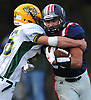 Nick LiCalzi #33 of South Side, right, fights for ground yards as Kyle Serro #55 of Lynbrook looks to tackle him during a Nassau County Conference III varsity football game at South Side High School in Rockville Centre on Thursday, Sept. 27, 2018. LiCalzi scored two touchdowns in South Side's 28-13 win.