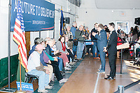 Campaign workers prep people who will be sitting behind Vermont senator and Democratic presidential candidate Bernie Sanders before he speaks to senior citizens at the Peterborough Community Center gymnasium in Peterborough, New Hampshire.
