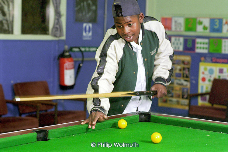 Playing pool at Neasden Youth Project on Chalkhill Estate in Wembley.  The project is supported by the Metropolitan Housing Trust Social Fund.