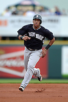 Shortstop Yangervis Solarte (89) of the New York Yankees during a spring training game against the Pittsburgh Pirates on February 26, 2014 at McKechnie Field in Bradenton, Florida.  Pittsburgh defeated New York 6-5.  (Mike Janes/Four Seam Images)
