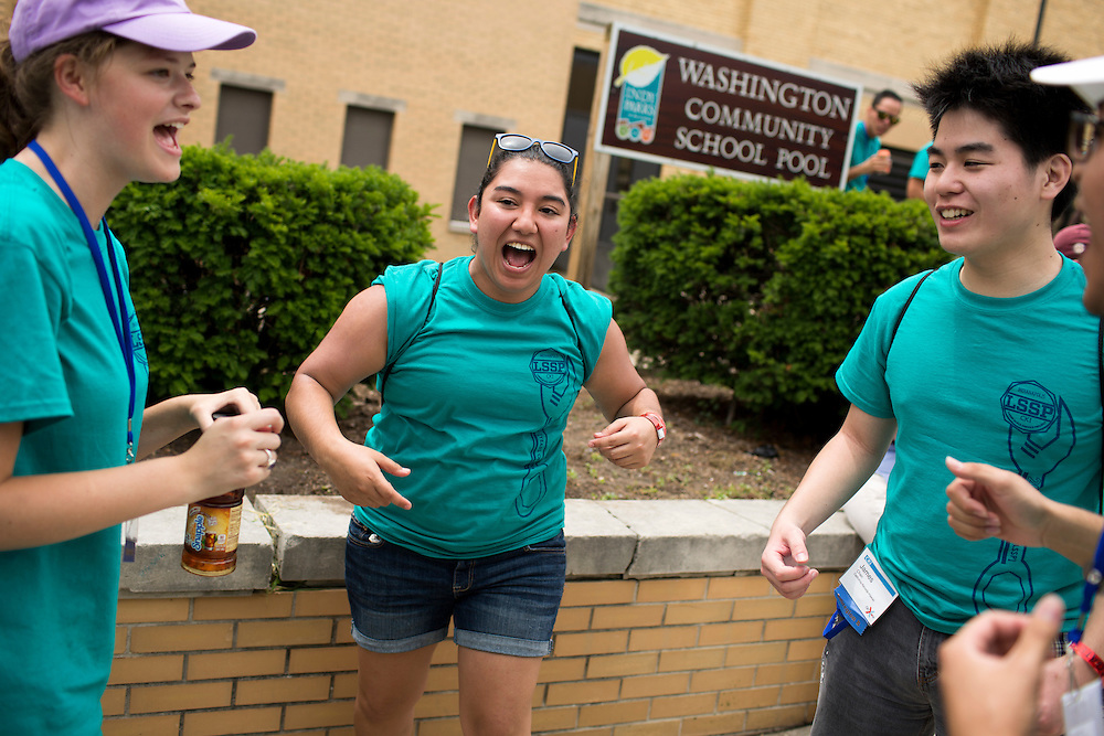 """Victoria Ortiz gets her group pumped up after lunch during """"Circle the City with Service,"""" the Kiwanis Circle K International's 2015 Large Scale Service Project, on Wednesday, June 24, 2015, in Indianapolis. (Photo by James Brosher)"""