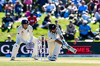 Ross Taylor of the Black Caps hits a ball with Jonny Bairstow of England looking on during the final day of the Second International Cricket Test match, New Zealand V England, Hagley Oval, Christchurch, New Zealand, 3rd April 2018.Copyright photo: John Davidson / www.photosport.nz