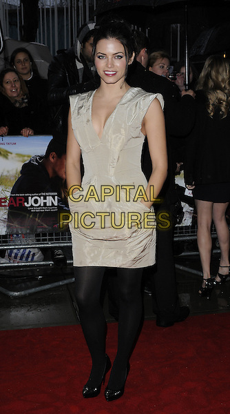 JENNA DEWAN .UK Gala Screening of 'Dear John' at the Odeon, Kensington, London, England, UK, March 30th 2010.arrivals full length sleeveless dress hand on hip black tights patent shoes ruched beige gold hands in pockets.CAP/CAN.©Can Nguyen/Capital Pictures.