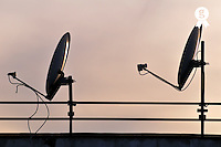 Two Satellite dishes and sunset sky (Licence this image exclusively with Getty: http://www.gettyimages.com/detail/sb10069714aa-001 )