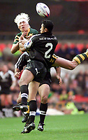 Picture by Shaun Flannery\SWpix.com - 25/11/00 - Rugby League World Cup Final 2000 - Australia v New Zealand, Old Trafford, manchester, England - Australia's Mat Rogers & New Zealand's Nigel Vagana fail to connect with the ball.