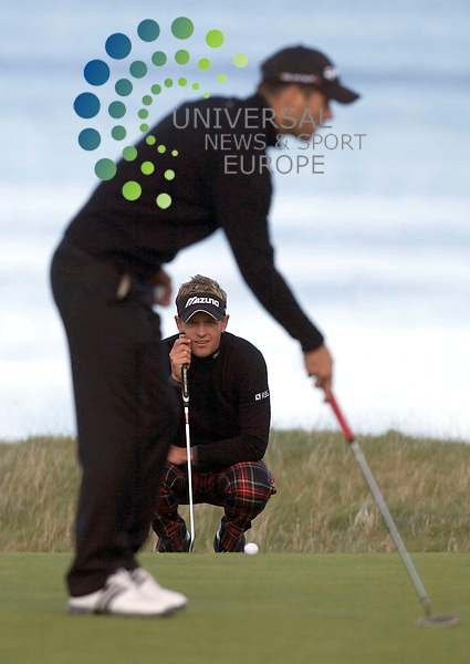 The Alfred Dunhill Golf Championship 2009 at The Old Course, St Andrews, Kingsbarns and Carnoustie.. .Overnight leader Luke Donald at 18 lines up his put with Jamie Redknapp in the forground lining up his during the Gale-Force Delayed Third  Round of the Alfred Dunhill Golf Championship...Picture by Mark Davison/ Universal News & Sport