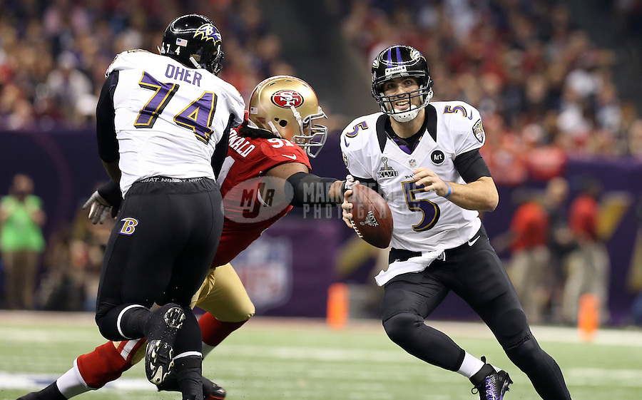 Feb 3, 2013; New Orleans, LA, USA; Baltimore Ravens quarterback Joe Flacco (5) scrambles from San Francisco 49ers defensive end Ray McDonald (91) while protected by Ravens tackle Michael Oher (74) in the first quarter in Super Bowl XLVII at the Mercedes-Benz Superdome. Mandatory Credit: Mark J. Rebilas-