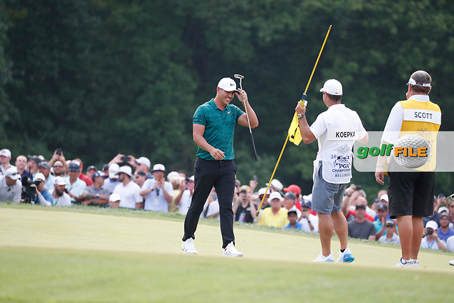 Brooks Koepka (USA) is congratulated by his caddie on the 18th green after winning the 100th PGA Championship at Bellerive Country Club, St. Louis, Missouri, USA. 8/12/2018.<br /> Picture: Golffile.ie | Brian Spurlock<br /> <br /> All photo usage must carry mandatory copyright credit (© Golffile | Brian Spurlock)