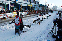 Zoya Denure leaves the starting line on 4th avenue in downtown Anchorage, Alaska during the ceremonial start of the 2011 Iditarod