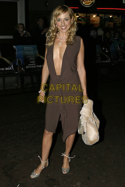 "SARAH MANNERS.""Beyond the Sea"" UK Premiere, .Vue Cinema, Leicester Square, .London, 25 November 2004..full length brown dress plunging neckline low cut.Ref: AH.www.capitalpictures.com.sales@capitalpictures.com.©Capital Pictures."