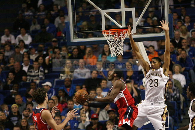 John Wall lays the ball up over Anthony Davis during a NBA Preseason game between the Washington Wizards and the New Orleans Pelicans at Rupp Arena in Lexington, Ky., on Saturday, October 19, 2013. Photo by Michael Reaves | Staff