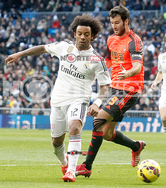 Real Madrid's Marcelo Vieira (l) and Real Sociedad's Imanol Agirretxe during La Liga match.January 31,2015. (ALTERPHOTOS/Acero) /NortePhoto<br /> /NortePhoto.com
