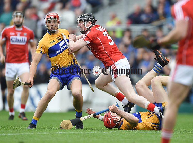 Peter Duggan of Clare in action against Damien Cahalane of Cork during their Munster Senior game at Pairc Ui Chaoimh. Photograph by John Kelly.