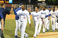 Chattanooga Lookouts Erisbel Arruebarrena (11), Juan Ramon Noriega (51) and O'Koyea Dickson (7) high five the coaching staff after a game against the Birmingham Barons on April 24, 2014 at AT&T Field in Chattanooga, Tennessee.  Chattanooga defeated Birmingham 5-4.  (Mike Janes/Four Seam Images)