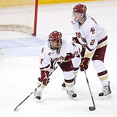 Steven Whitney (BC - 21), Brian Dumoulin (BC - 2) - The Boston College Eagles defeated the University of Massachusetts-Amherst Minutemen 2-1 (OT) on Friday, February 26, 2010, at Conte Forum in Chestnut Hill, Massachusetts.