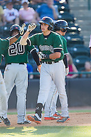 Ryder Jones (15) of the Augusta GreenJackets high fives teammates after hitting a home run against the Hickory Crawdads at L.P. Frans Stadium on May 11, 2014 in Hickory, North Carolina.  The GreenJackets defeated the Crawdads 9-4.  (Brian Westerholt/Four Seam Images)