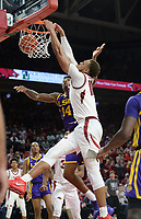NWA Democrat-Gazette/ANDY SHUPE<br /> Arkansas forward Daniel Gafford dunks the ball over LSU guard Marlon Taylor (14) Friday, Jan. 11, 2019, during the second half of play in Bud Walton Arena in Fayetteville. Visit nwadg.com/photos to see more photographs from the game.