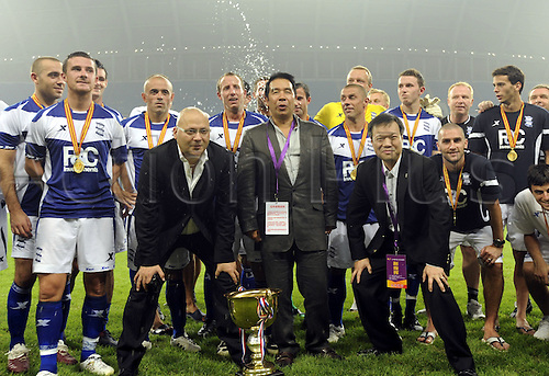 Jul 24, 2010; Shenyang, CHINA; Birmingham City defeats Liaoning Hongyun 2:0 in a friendly match at the Shenyang Olympic Stadium during their China and Hong Kong tour. Carson Yeung, owner of Birmingham, poses with his squad after the trophy presentations