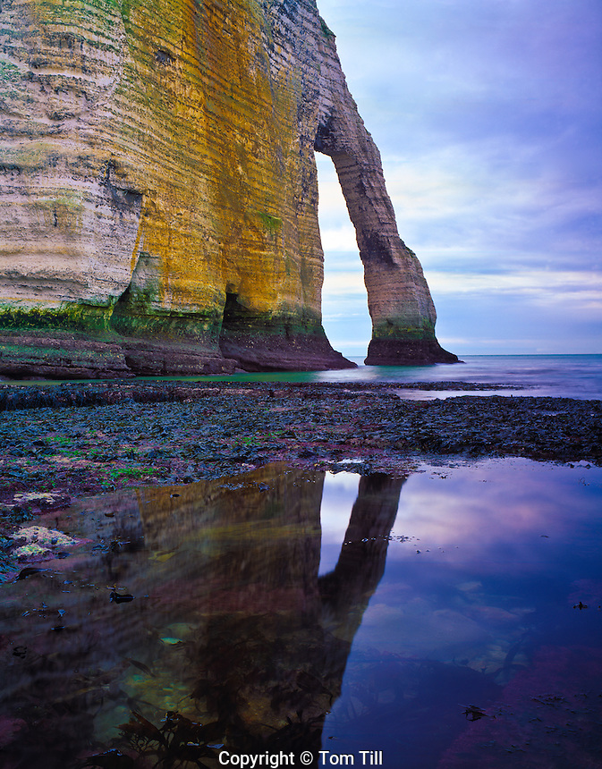 Sea arch on the Atlantic  White cliffs  of Etretat, France  Atlantic Ocean, Normandy Reflection in tide pools  Afternoon
