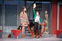 """Rosie Stevenson as DOMINATOR and Hilary Kang Oglesby as HELEN SPECTACULAR (with hat)<br /> Photo from the dress rehearsal of the Occidental College Department of Theater presentation of U-R-U by Julia Lederer, directed by Edgerton Guest Artist Jessica Kubzansky, Nov. 28, 2018 in Keck Theater.<br /> First daughter Helen Spectacular travels to Robo Island (Silicon Valley meets the Bermuda Triangle) on a secret mission to free thousands of robots from servitude. Absurdly comic and existentially chilling, U-R-U examines the societal obsession with progress at all costs and the decreasing worth of humanity in this increasingly artificial world.<br /> U-R-U is based on a 1920 science fiction play by the Czech writer Karel Čapek called R.U.R., which was the first time the word """"robot"""" was used.<br /> (Photo by Marc Campos, Occidental College Photographer)"""