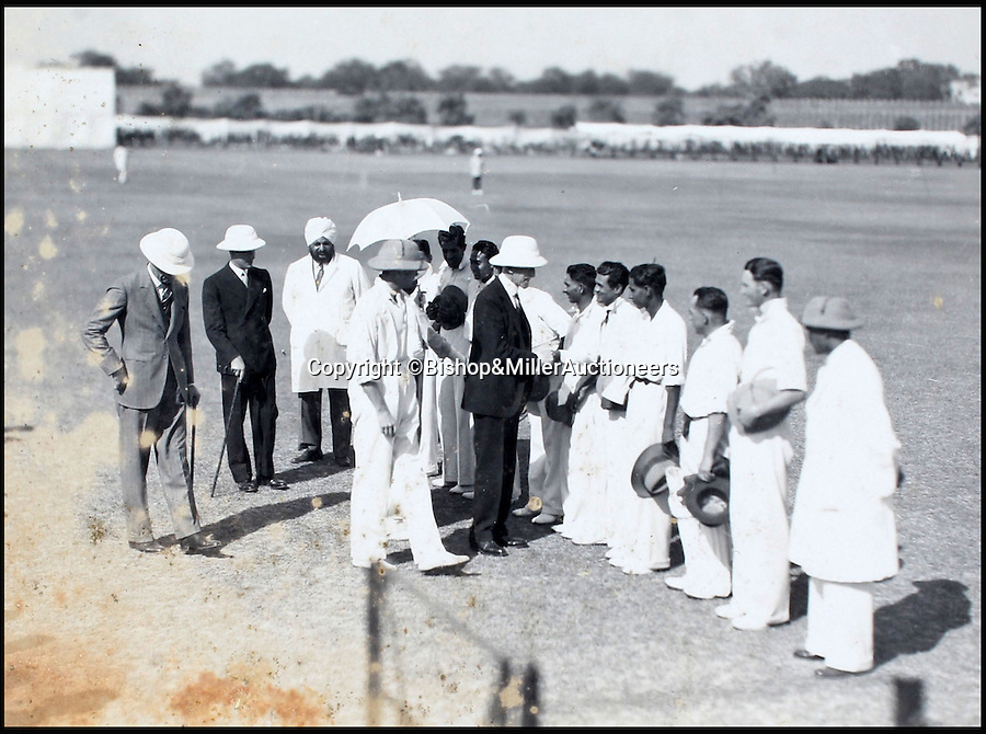 BNPS.co.uk (01202 558833)<br /> Pic: Bishop&MillerAuctioneers/BNPS<br /> <br /> The Delhi & District XI being presented to their excellencies.<br /> <br /> A fascinating album of photographs showing the first England cricket tour of India and the last for controversial 'Bodyline' captain Douglas Jardine has been discovered.<br /> <br /> The rare black and white images show the England star leading the national side at the new cricket ground in Delhi that the colonial British had built in 1933 - the same year as the brutal Ashes series.<br /> <br /> Jardine is featured in many photos as is the Viceroy of India. The album is being sold by auctioneers Bishop and Miller of Suffolk.