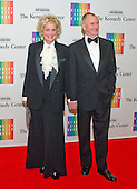 Christine Ebersole and William Moloney arrive for the formal Artist's Dinner honoring the recipients of the 2013 Kennedy Center Honors hosted by United States Secretary of State John F. Kerry at the U.S. Department of State in Washington, D.C. on Saturday, December 7, 2013. The 2013 honorees are: opera singer Martina Arroyo; pianist,  keyboardist, bandleader and composer Herbie Hancock; pianist, singer and songwriter Billy Joel; actress Shirley MacLaine; and musician and songwriter Carlos Santana.<br /> Credit: Ron Sachs / CNP