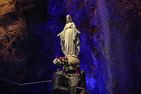 Statue of the Virgin in front of the rock on which the oratory is built, in the Oratoire Saint-Joseph du Mont-Royal, a catholic basilica and national shrine built 1924-67 in Italian Renaissance style on Mount Royal's Westmount Summit, Montreal, Quebec, Canada. The interior was designed by Gerard Notebaert, with seating for 2028. The oratory was designed by architects Dalbe Viau, Alphonse Venne, Lucien Parent, Emilien Bujold and Dom Paul Bellot. It is listed as a National Historic Site of Canada. Picture by Manuel Cohen
