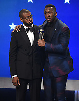 SANTA MONICA - JANUARY 13: Mahershala Ali (R) accepts the award for Best Supporting Actor with Kris Bowers on the 24th Annual Critics' Choice Awards at the Barker Hangar on January 13, 2019, in Santa Monica, California. (Photo by Frank Micelotta/PictureGroup)