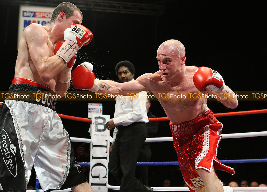 Ben Murphy (red shorts) defeats Lee Cook in a Lightweight boxing contest for the Southern Area Title at the Brentwood Centre, promoted by Frank Maloney - 22/01/10 - MANDATORY CREDIT: Gavin Ellis/TGSPHOTO - Self billing applies where appropriate - Tel: 0845 094 6026