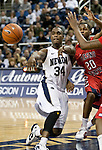 January 21, 2012:   Nevada Wolf Pack guard Malik Story passes in front of Fresno State Bulldogs guard Garrett Johnson in the first half during their NCAA game played at Lawlor Events Center in Reno, NV.