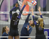 NWA Democrat-Gazette/ANDY SHUPE<br /> Har-Ber's Halle Roberts (center) sends the ball over the net as Fayetteville's Rosana Hicks (5) and Lyndsey Mylius (8) defend Wednesday, Sept. 13, 2017, during play in Bulldog Arena. Visit nwadg.com/photos to see more photographs from the match.